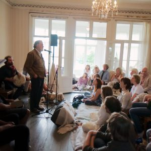 Barks reciting Rumi poetry to a small audience at the Festival of Silence, Norway. Haakon Thue Lie.