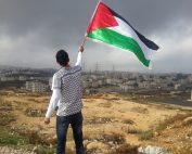 Man waving Palestine flag, showing the importance of international solidarity.